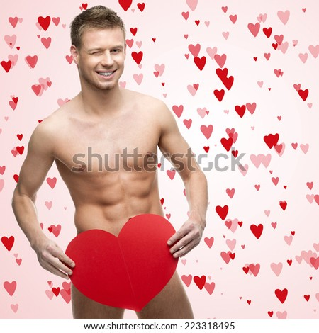 funny naked man holding red heart - stock photo