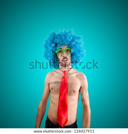 funny naked man with blue wig on blue background