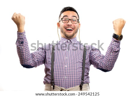 Funny nerd celebrating with hands up - stock photo