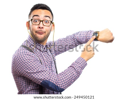 Funny nerd pointing his watch - stock photo