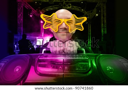 Funny nerd with boom box and star glasses on disco - stock photo