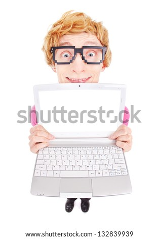 Funny nerdy guy showing laptop screen with your text - stock photo