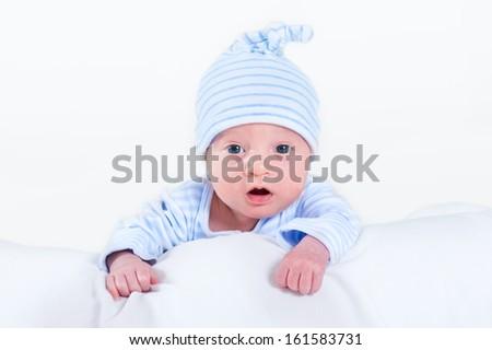 Funny newborn baby boy playing on his tummy - stock photo