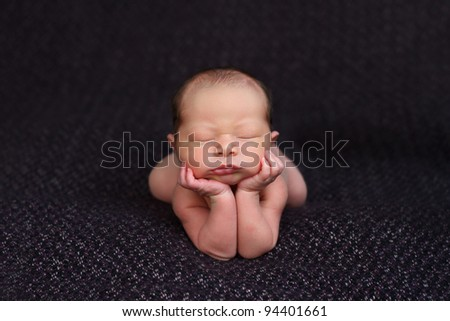 Funny newborn baby up on elbows. mix race: Caucasian and Asian - stock photo