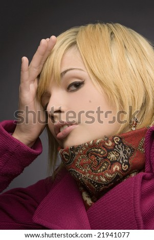 funny nice blond girl on a dark background