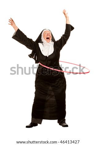 Funny nun exercising with toy plastic hoop - stock photo
