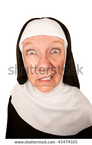 Funny Nun with Angry Expression on her Face - stock photo