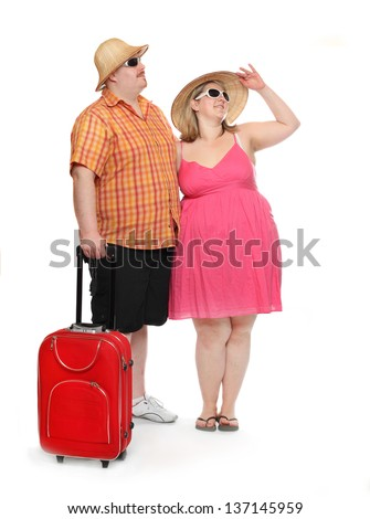 Funny obese couple going to holidays. - stock photo