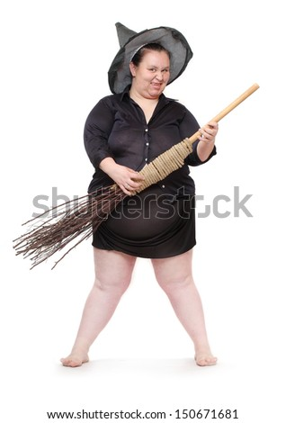 Funny obese witch with her magic broomstick. Haloween concept. - stock photo