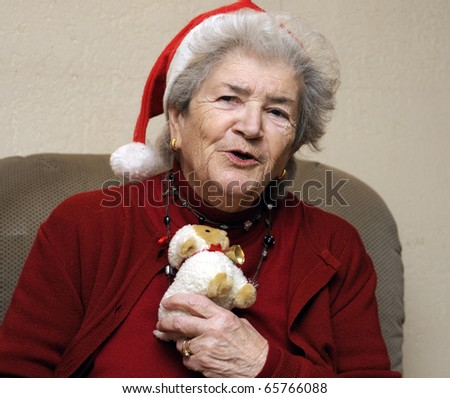 Funny old senior woman at christmas party - stock photo