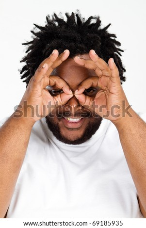 funny overweight african american man making faces - stock photo