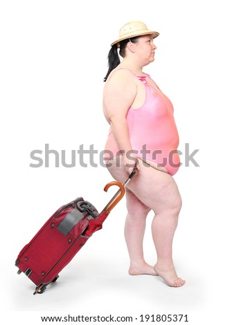 Funny overweight woman in swimsuit going to vacations.  - stock photo