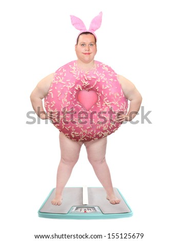 Funny overweight woman on a weight scale. Weight loss concept. - stock photo