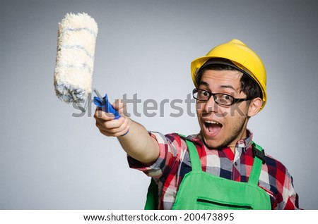 Funny painter with hardhat and roller - stock photo