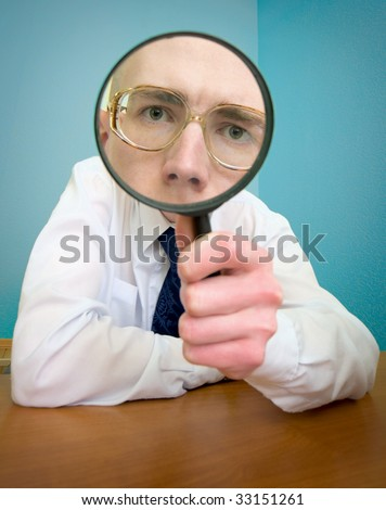 Funny people with a magnifier in a hand - stock photo