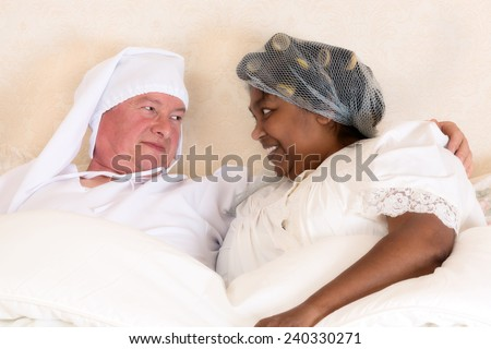 Funny photo of a vintage happy couple in bed - stock photo