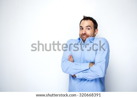 Funny photo of businessman with beard wearing shirt. Businessman looking at camera and shrugging his shoulders with discomfort. Isolated on white background - stock photo