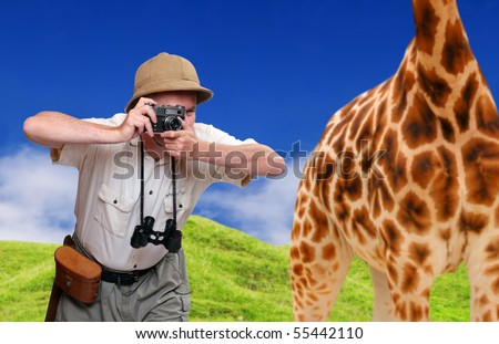 Funny picture. Crazy wildlife photographer and giraffe. Telephoto style - shallow DOF. Great for calendar. - stock photo
