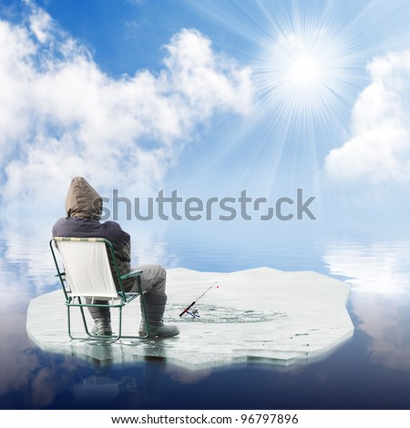 Funny picture of a fisherman catching a fish on ice. - stock photo