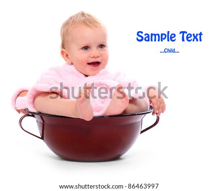 Funny picture of a happy child sitting in the big pot with space for your text. - stock photo