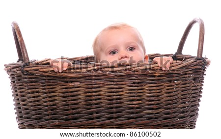 Funny picture of a hiding child in a basket. Birth metaphor.