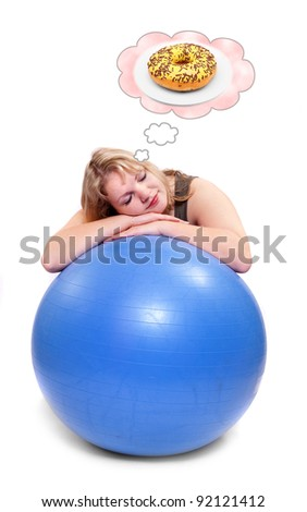 Funny picture of a hungry overweight woman dreaming on ball. Health care concept. - stock photo