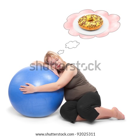 Funny picture of a hungry overweight woman practising with ball. Health care concept. - stock photo