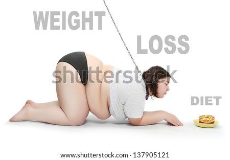 Funny picture of an hungry obese woman chained near plate with food. Weight loss concept. Picture with space for your text. - stock photo