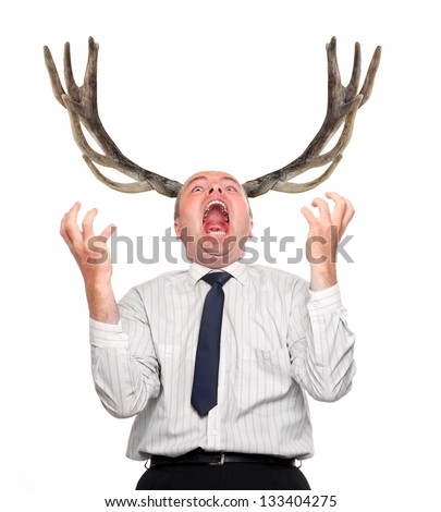 Funny picture of an stupid manager (husband) with great antlers. Incapacity concept. - stock photo