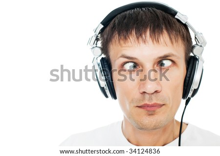 funny picture of man with headphones on white - stock photo