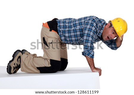 funny picture of tradesman looking stunned - stock photo