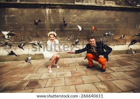 funny picture of wedding couple in old city - stock photo