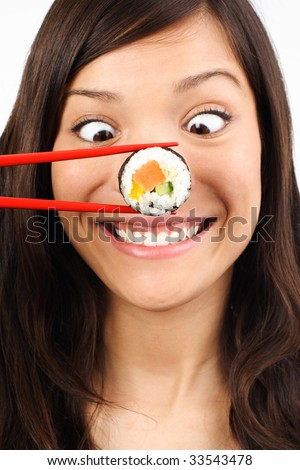 Funny picture of woman with salmon maki sushi. - stock photo