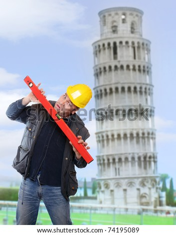 Funny picture of worried builder using a spirit level against  leaning tower of Pisa. - stock photo