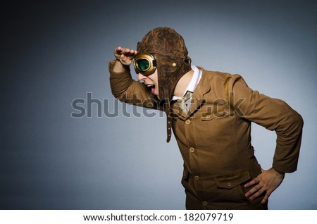 Funny pilot with goggles and helmet - stock photo