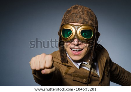 Funny pilot with goggles and helmet