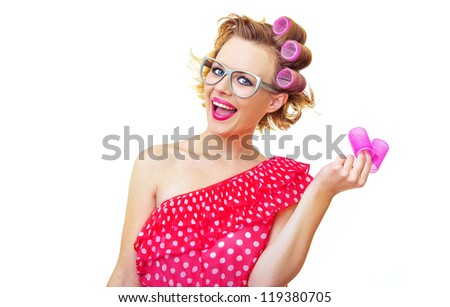 Funny Pin-Up Girl holding curlers, isolated on white - stock photo