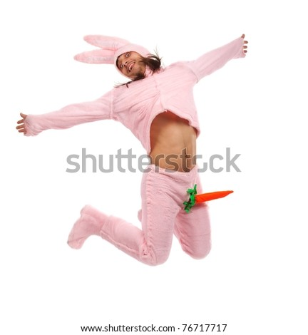 Funny pink rabbit jumping on white background - stock photo