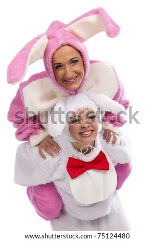 Funny pink rabbit jumping on white rabbit isolated on white background - stock photo