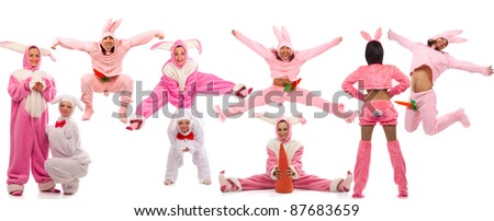 Funny pink rabbits have a fun isolated on white background - stock photo