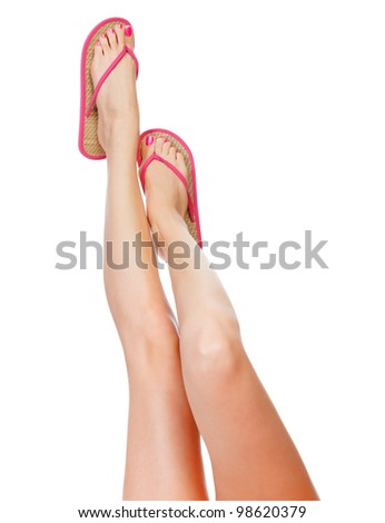 Funny pink sandals on female feet. Isolated on white background - stock photo