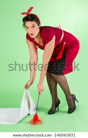 Funny pinup girl doing household chores - stock photo