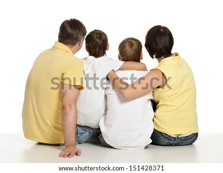 Funny portrait from the back a family of four spending time together - stock photo