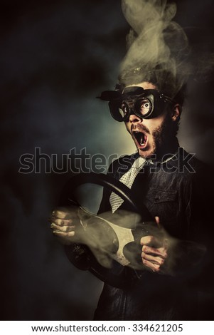 Funny portrait of a crazy male driver with smoking head and detached steering wheel. Speed car racing - stock photo