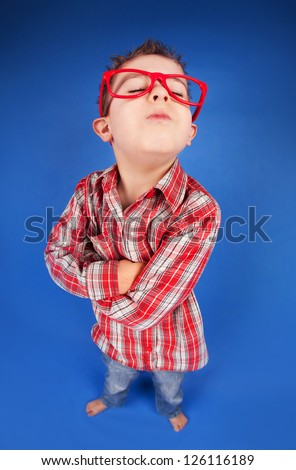 Funny portrait of a five years old sulky boy - stock photo