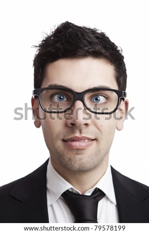 Funny portrait of a young businessman with crooked eyes wearing nerd glasses - stock photo