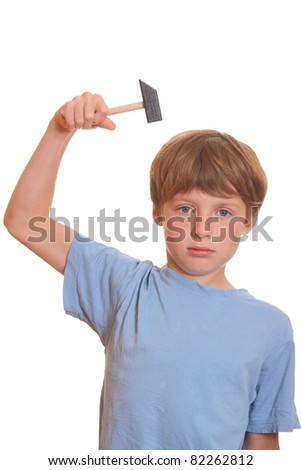 Funny portrait of a young frustrated teenage boy with a hammer - stock photo