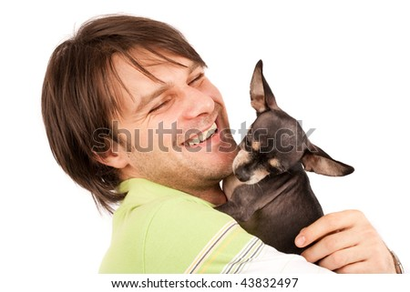 Funny portrait of a young man holding a cute chihuahua dog - stock photo