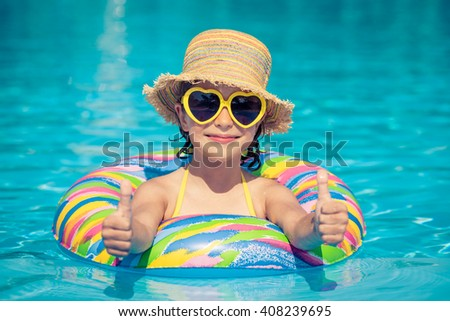 Funny portrait of child. Kid having fun in swimming pool outdoors. Summer vacation and healthy lifestyle concept - stock photo