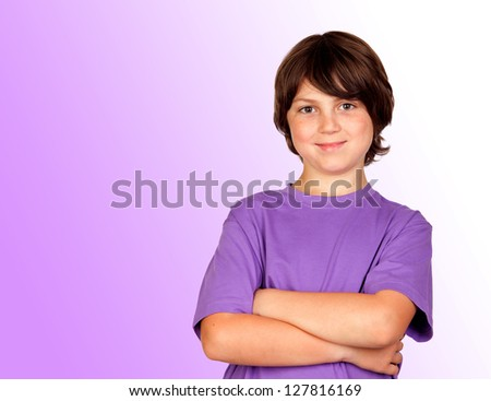 Funny portrait of freckled boy isolated on a purple background